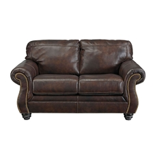 Signature Design by Ashley Bristan Leather Loveseat in Walnut